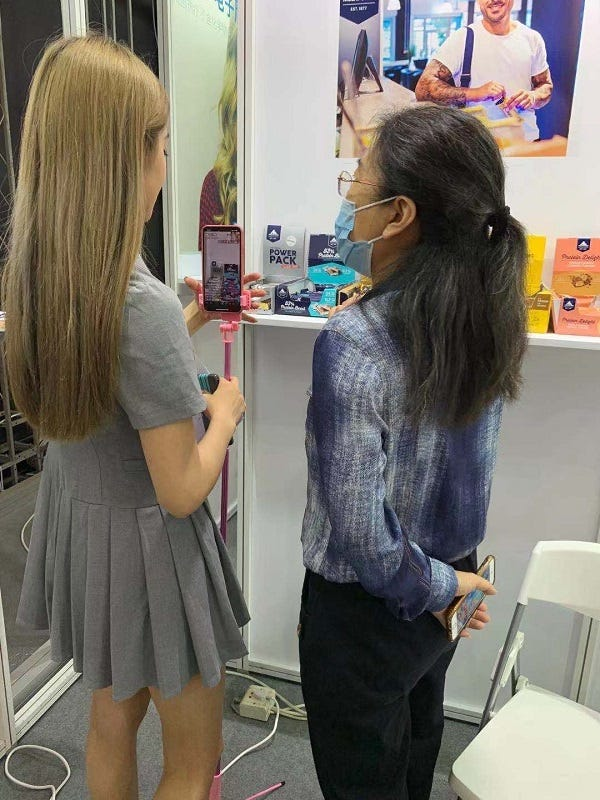 The influencer YingYing before the start of the live stream presentation of the Multipower products